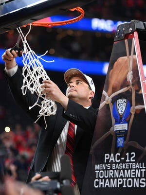 Arizona head coach Sean Miller cuts the net after defeating the USC Trojans to win the Pac-12 Tournament.