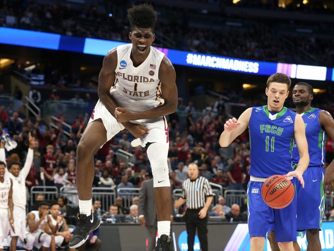 FSU's Jonathan Isaac celebrates after a dunk against