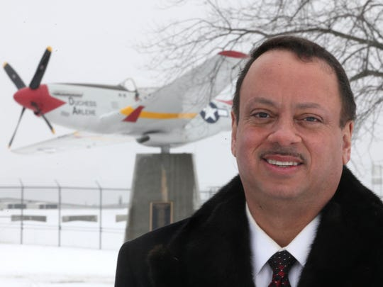 "Robert V. Morris founded the Fort Des Moines Memorial Park and the WWII Iowa Tuskegee Airmen Memorial, which is shown in the background, near the Air National Guard on McKinley. He was the author of ""Black Faces of War: A Legacy of Honor from the American Revolution to Today."" Morris, 59, died Feb. 15, 2018."