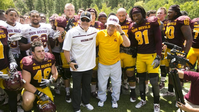 ASU head football coach Todd Graham (center left) poses for a photo with former ASU head football coach Frank Kush and ASU football players following the ASU football scrimmage at Camp Tontozona in the Tonto National Forest outside of Payson on August 15, 2015.
