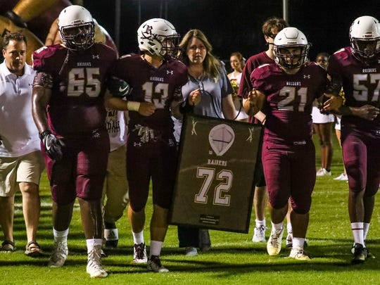 A ceremony honoring Zach Martin-Polsenberg was held before the game between Palmetto Ridge and Riverdale. His family waked with his teammates as they carried Zach's jersey in his memory.