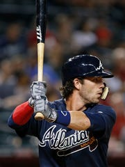 Dansby Swanson of the Atlanta Braves steps up to the plate for his first at-bat against the Diamondbacks at Chase Field on Aug. 22, 2016 in Phoenix, Ariz.