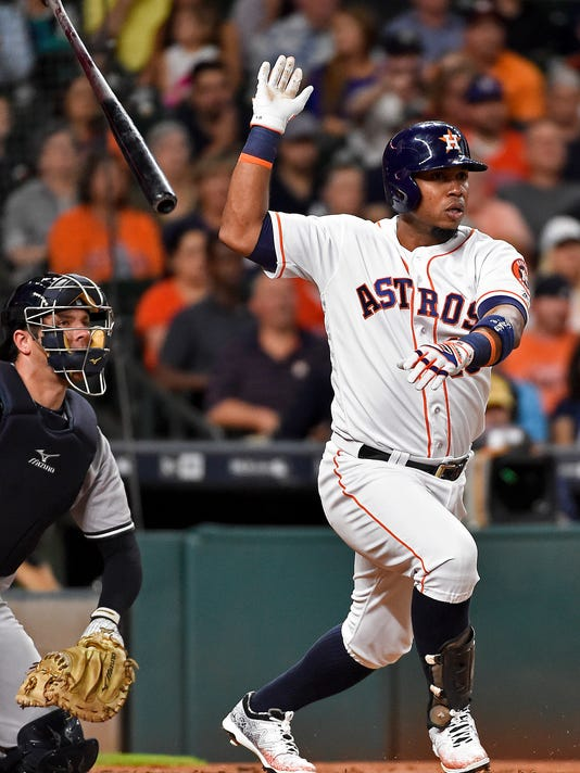 Houston Astros' Luis Valbuena watches his base hit in the second inning of a baseball game against the New York Yankees, Monday, July 25, 2016, in Houston. (AP Photo/Eric Christian Smith)