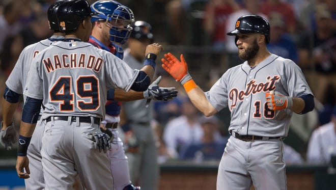 Tigers shortstop Dixon Machado and leftfielder Tyler Collins celebrate Collins' three-run home run during the fifth inning Monday in Arlington, Texas.