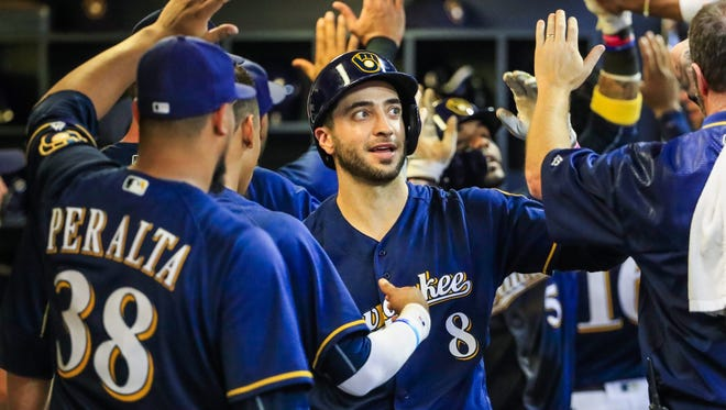 Ryan Braun celebrates with teammates in the dugout after hitting a three-run home run in the sixth inning on Tuesday.