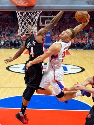 Los Angeles Clippers forward Blake Griffin, right, goes up for a dunk as Portland Trail Blazers forward Maurice Harkless defends during the second half in Game 2 of a first-round NBA basketball playoff series, Wednesday, April 20, 2016, in Los Angeles. The Clippers won 102-81.