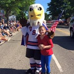 USA Hockey NTDP mascot Rushmore makes this young hockey fan's day during a 2015 community event. The team is looking for another person to fill the eagle costume this season.