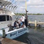 PHOTOS: Locals catch monstrous 8-foot, 634-pound bluefin tuna