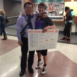 North Henderson wrestling coach Heang Uy, left, and Mitchel Langford