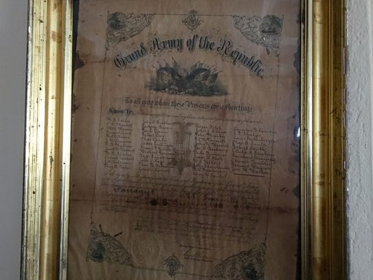 A framed membership list for the Grand Army of the
