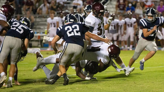 Benedictine's Justin Thomas (No. 4) dives forward for a gain against Effingham County last Friday in Springfield. Benedictine won 49-7.