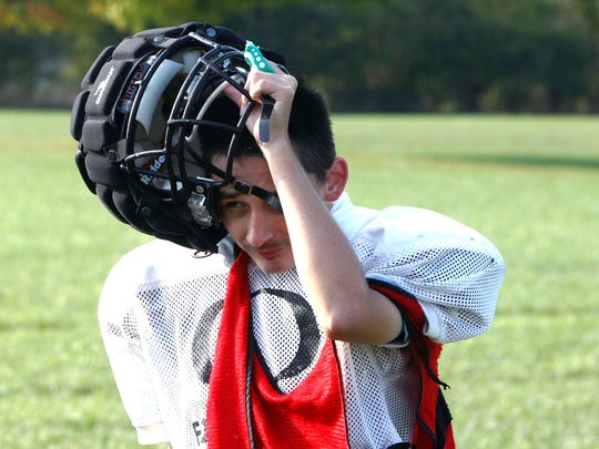 Riley Lowder pulls off his helmet for a quick drink