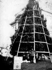 Scaffolding is seen as a tree on the Marion County Courthouse grounds is decorated in 1913. It was the first year of a tradition that spanned nearly four decades.
