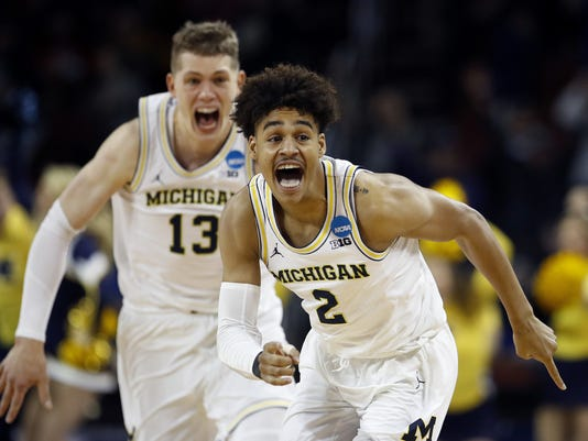 purchase cheap 39c95 9d4ce NCAA Tournament: Milwaukee's Jordan Poole beats buzzer ...