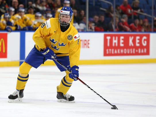 Rasmus Dahlin of Sweden plays the puck during the IIHF