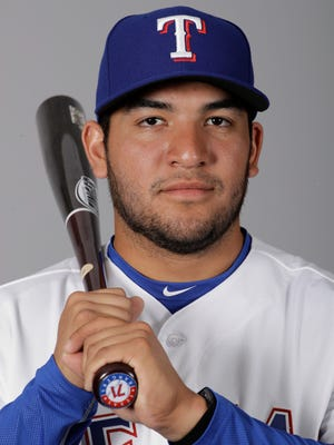 Rangers catching prospect Jose Trevino, a John Paul II grad, is in his first Major League camp this spring.