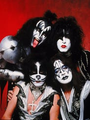 Members of the rock group Kiss, clockwise from top