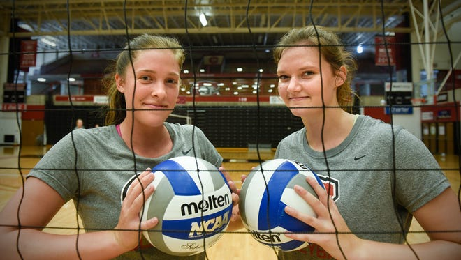 St. Cloud State's Abby Templin, left, and Erin Navratil pose for a photograph during practice Wednesday, Sept. 13, at Halenbeck Hall in St. Cloud.