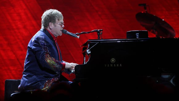 Elton John and his band perform during the Final Curtain