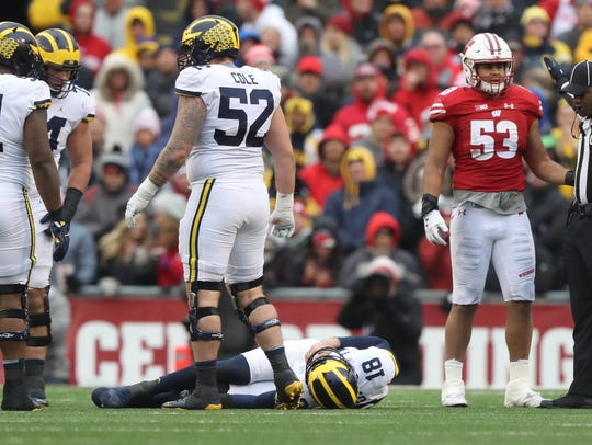 Brandon Peters is hurt during the third quarter Nov. 18 at Camp Randall Stadium in Madison, Wis.