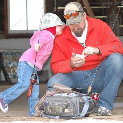 Elsie Berdan and her dad, Doug, get ready to go fishing.