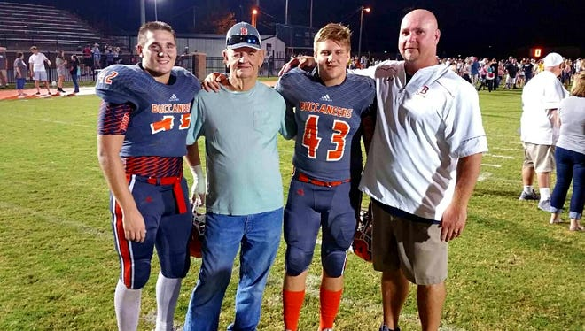 Beech High junior Heath Crabtree stands with his grandfather, David Crabtree, his younger brother, freshman Will Crabtree, and his father, Beech head coach Anthony Crabtree after a recent game.