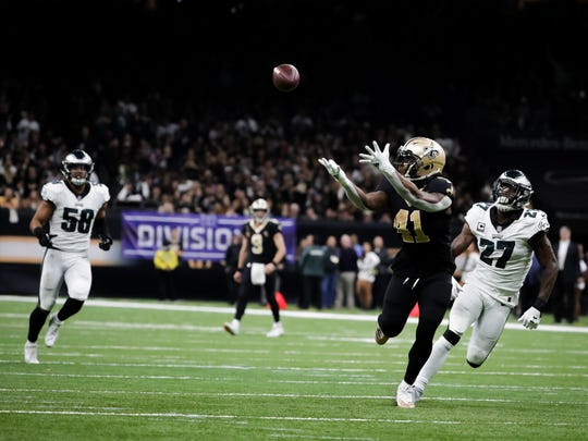 Jan 13, 2019; New Orleans, LA, USA; New Orleans Saints running back Alvin Kamara (41) catches a touchdown pass over Philadelphia Eagles strong safety Malcolm Jenkins (27) but the play would be negated by a penalty during the third quarter of a NFC Divisional playoff football game at Mercedes-Benz Superdome. Mandatory Credit: Derick E. Hingle-USA TODAY Sports