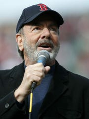 "Neil Diamond sings ""Sweet Caroline"" during a 2013 game between the Boston Red Sox and the Kansas City Royals. Diamond's ""Sweet Caroline,"" Earth, Wind & Fire's ""September"" and Sam & Dave's ""Soul Man"" are among 25 recordings being inducted to the National Recording Registry."