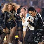 Recording artist Beyonce, Coldplay singer Chris Martin and recording artist Bruno Mars perform during halftime in Super Bowl 50 at Levi's Stadium.