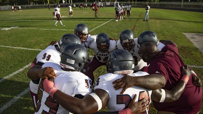 Members of the Palm Beach Lakes football team huddle before a game last season. Sunday, the Palm Beach Lakes football Twitter account published a video that featured players and coaches calling for racial equality.