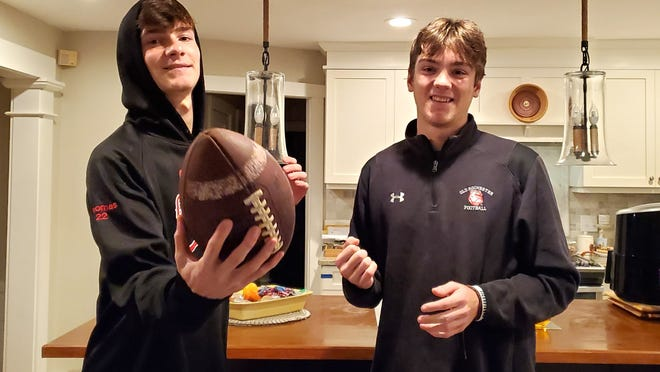 Dylon, left and Ryon Thomas in their kitchen in Mattapoisett. The twin brothers have been dedicated to improving their football skills despite obstacles.