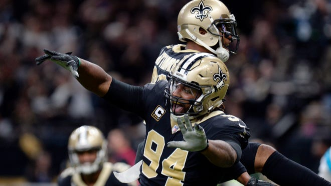 New Orleans Saints defensive end Cameron Jordan (94) celebrates a defensive stop in the second half of an NFL football gamemagainst the Carolina Panthers in New Orleans, Sunday, Jan. 7, 2018. (AP Photo/Bill Feig)