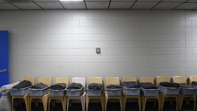 Chairs line a wall in the Washoe County Jail's intake area.
