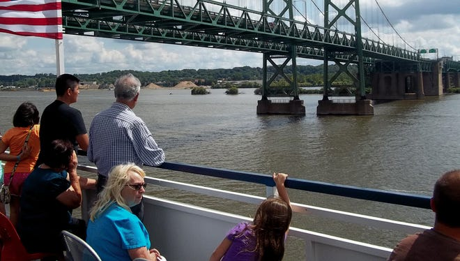 Tourists admire the Iowa-Illinois Memorial Bridge at Davenport last weekend from the top deck of a Mississippi paddle-wheeler.  Although the two spans look identical, the northbound span was finished in 1935 and southbound added in 1960.  Traffic count is 70,000+ vehicles daily.