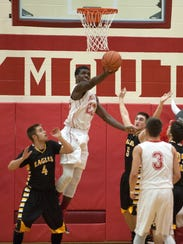 Plymouth's Tyrell Edmiston shoots the ball during their