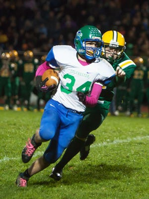 Colchester's Matt Hesford (34) turns the corner on a first-half carry against BFA-St. Albans on Friday night in St. Albans. Hesford scored on the Lakers' first two possessions in a 32-20 victory.