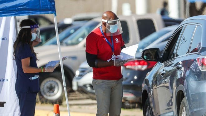 Austin school district staff on Monday offered COVID-19 tests to Austin High School staff and students after the district closed the campus due to the spread of the coronavirus.