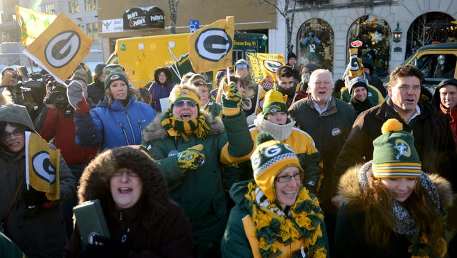 Fans get pumped up for another Green Bay Packers playoff run during a Jan. 9 pep rally in downtown Green Bay.