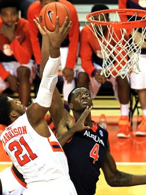 Clemson's Damarcus Harrison, left, drives to the basket as Auburn's Trayvon Reed defends in the second half of their NCAA college basketball game on Sunday, Dec. 14, 2014 in Clemson, S.C. (AP Photo/Anderson Independent-Mail, Mark Crammer)   THE GREENVILLE NEWS OUT, SENECA NEWS OUT