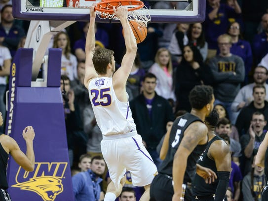 Northern Iowa forward Bennett Koch (25) completes a slam dunk as Xavier's Kaiser Gates (22) looks on during the first half at McLeod Center on Friday, Dec. 22, 2017, in Cedar Falls, Iowa.