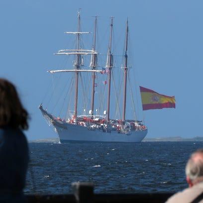 Spectators watch the Spanish Navy Training ship Juan