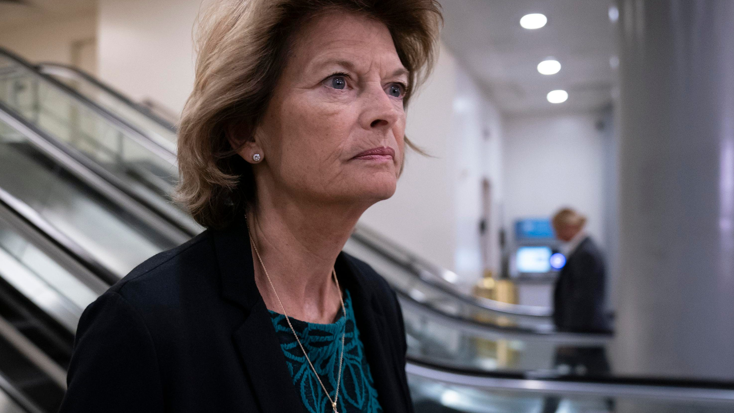 Sen. Lisa Murkowski, R-Alaska, was the target of a man's alleged threat to hire an assassin, according to court documents unsealed Wednesday.