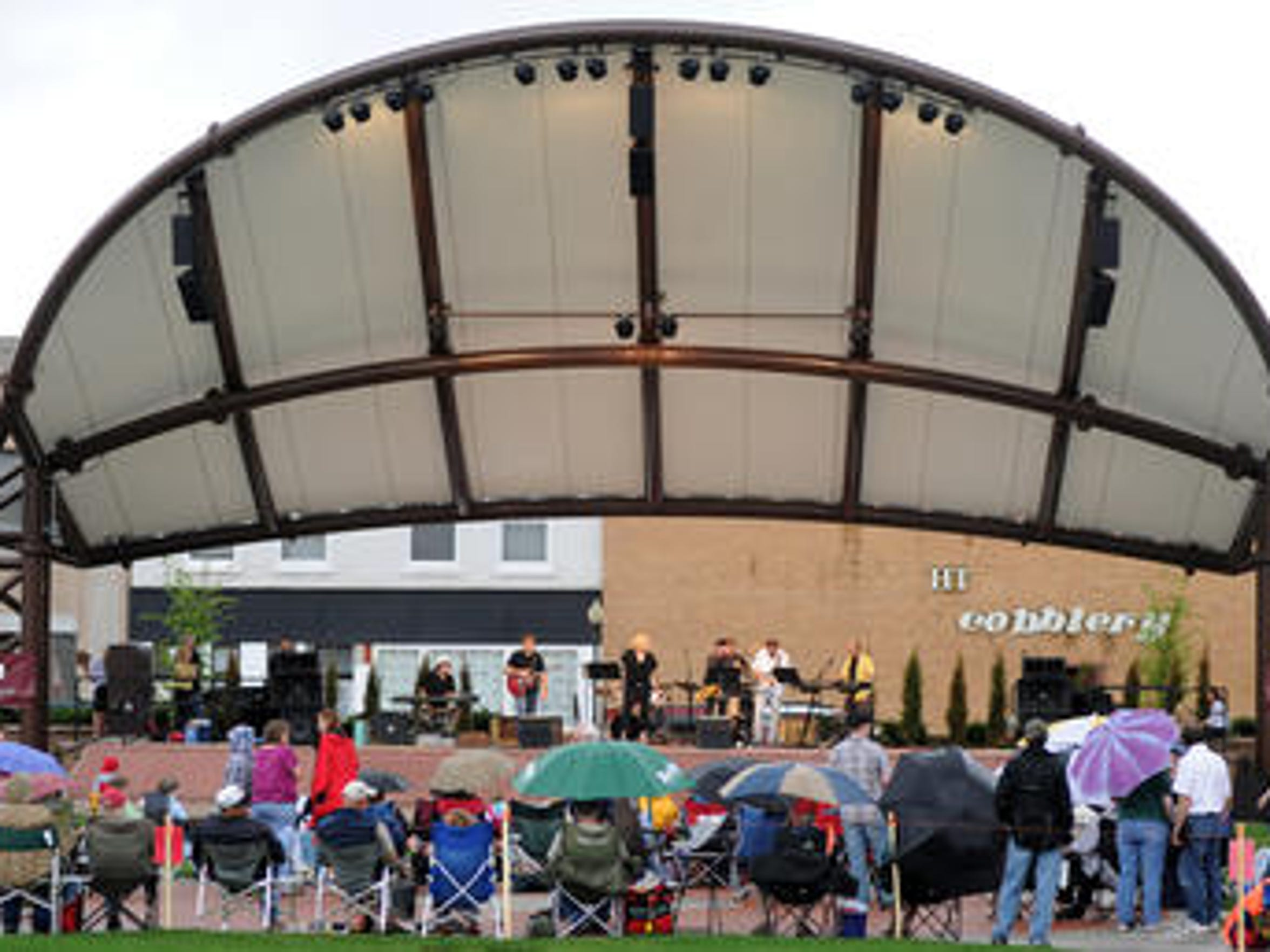 Johnny Altenburgh & The Mo-Tones play at a Concerts on the Square performance by in downtown Wausau in 2011.