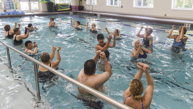 People participate in an aqua fitness class at the Fort Collins Senior Center in 2015.