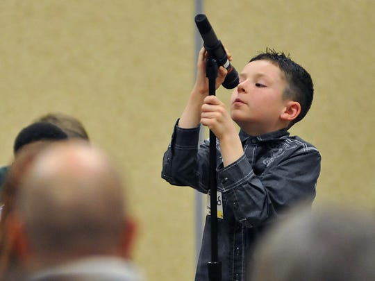 Drayton Berry, a 4th grader at Lexington school, tries to reach the mic during the Richland County Spelling Bee.