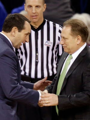 Duke coach Mike Krzyzewski, left, and Michigan State coach Tom Izzo talk before the Final Four semifinal game on April 4, 2015, in Indianapolis.