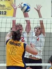 St. Philip's Maddie Hallacy (2) and Maya Segovia (7) try to block Climax Scotts' Madison Edwards (12) Thursday night.