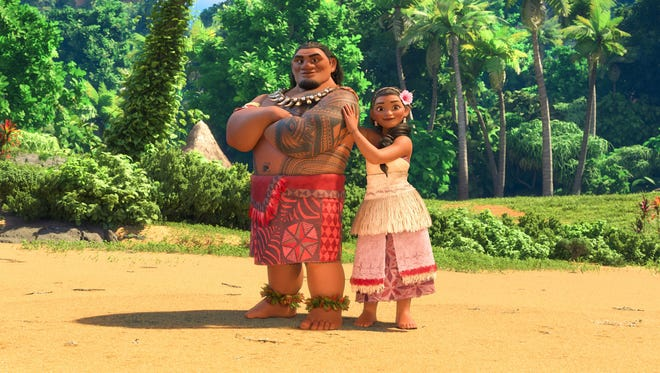 Chief Tui (voiced by Temuera Morrison) and his wife Sina (Nicole Scherzinger) are torn about their daughter's dreams of being a voyager in 'Moana.'
