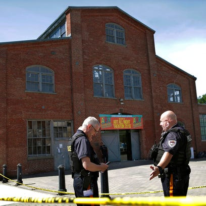 Police stand guard outside the warehouse building where