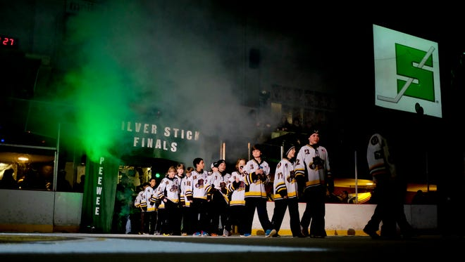 Teams walk out onto the ice during the Silver Stick opening ceremony Friday, January 23, 2015 at McMorran Arena.